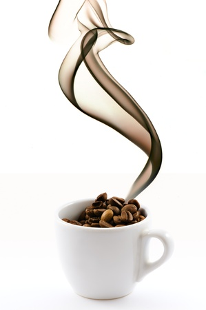 white cup with coffe beans and smoke photo