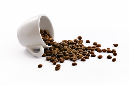 coffee harvest: white cup with coffe beans isolated