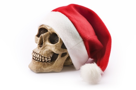 skull with red christmas hat on white background photo