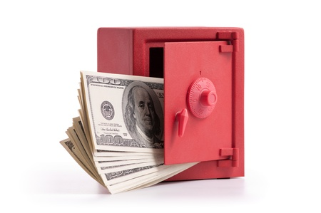 red door: little red safe with the door open and a stack of dollar bills Stock Photo