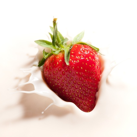 strawberry dropped in yogurt photo