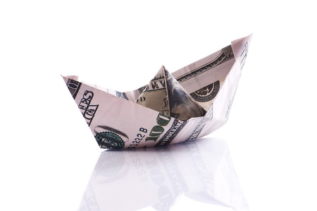 paper boat from dollar banknote on white photo