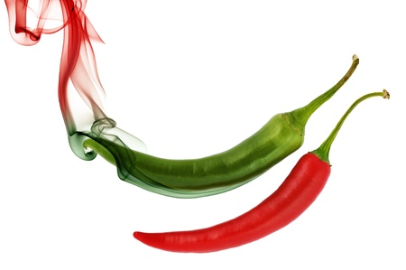 red and green hot chili pepper with color smoke on white photo