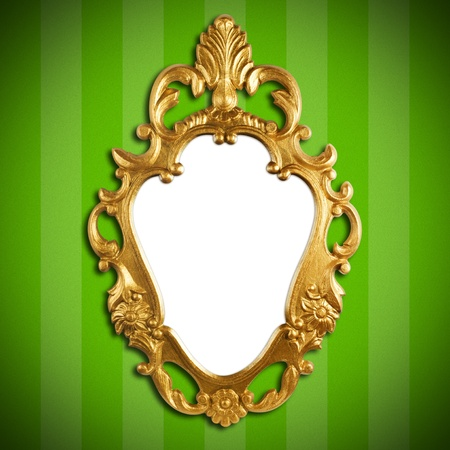 mirror image: gold vintage metal frame on wall Stock Photo