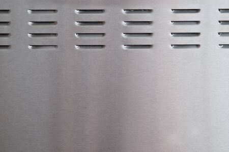 metal grate: brushed metal with perforation  Stock Photo