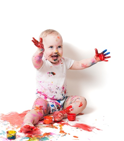 year-old child playing with paints photo