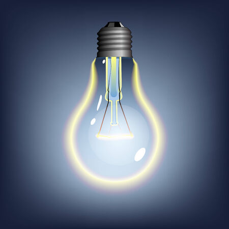 glowing lightbulb on dark background