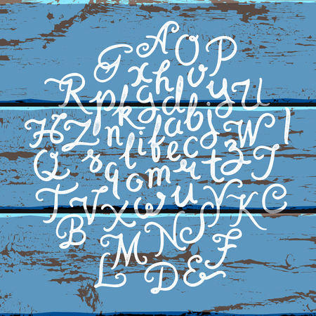 painted wood: Handwritten alphabet font. Hand drawn brush script letters on the old painted wood panels background. Stock lettering typography