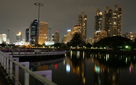 benjakitti: Business building with light and reflection, view from Benjakitti park in Bangkok, Thailand