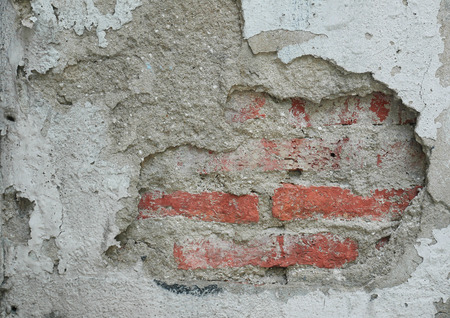 The cement wall have cracked . Its showed about the olded brick of wall. Can be use as background.