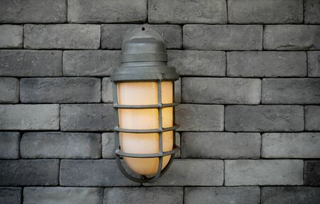 ceiling: The lantern on the vintage brick wall. Background of old vintage wall.