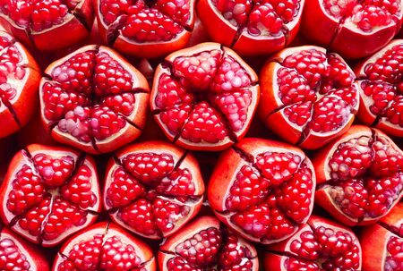 grained: Close up image of red pomegranate fruit.