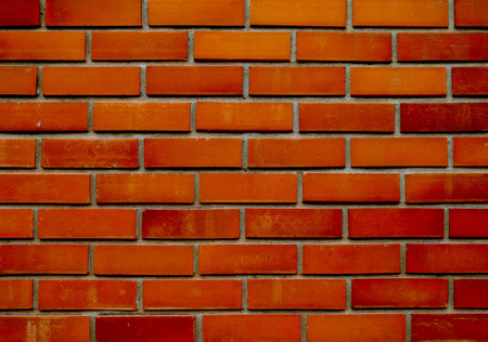orange-brown brick wall pattern background. rough solid texture and grunge surface. Can be use for decorative concept.