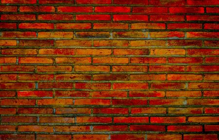 Vintage orange-brown brick wall pattern background. rough solid texture and grunge surface. Can be use for decorative concept. Stock Photo