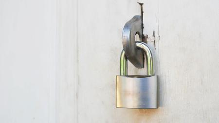 Steel lock on the white wooden door background