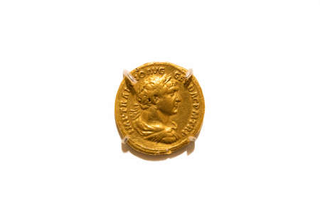 Leiden, The Netherlands - JAN 04, 2020: closeup of an old golden coin from the roman empire. Trajan Denarius. IMP TRAIANO AVG GER DAC P M TR P. 103-111 ad. Rome coin.