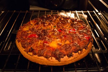 A tasty home made pizza just out of the hot oven.