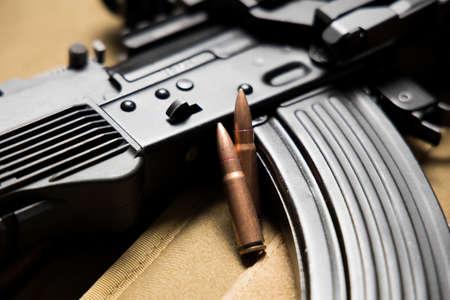 Closeup of a MKK-104 assault rifle with bullets.