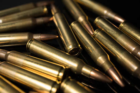 Closeup of a pile of .223 5.56x45 rifle bullets. Automatic rifle ammo.