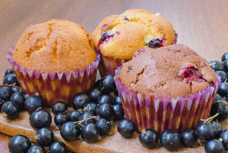 three muffins with blackcurrant photo