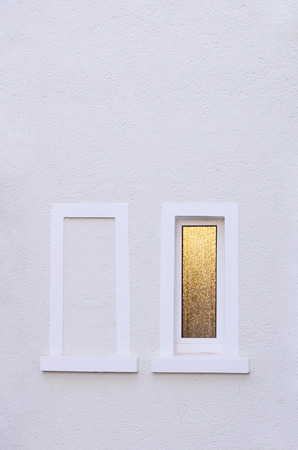 unhindered: two windows, one walled up Stock Photo