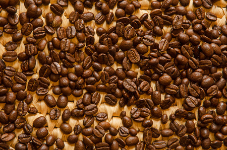 espresso coffee beans on a woven tray photo
