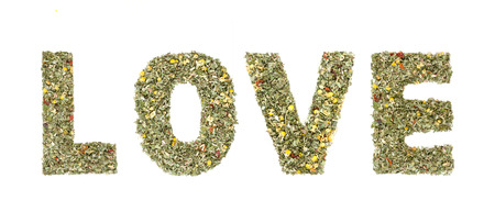 spelled: Word LOVE spelled out with herbs and tea leaves