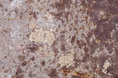 partially: partially wet and weathered industrial surface