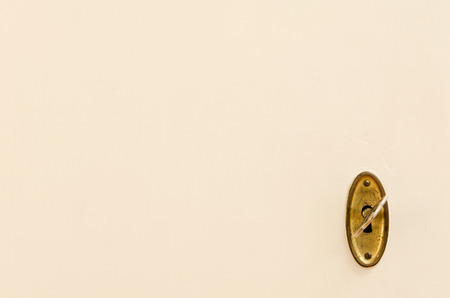 close fitting: wooden door with vintage keyhole and key