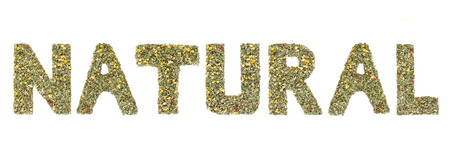 noun: Word NATURAL spelled out with herbs and tea leaves Stock Photo