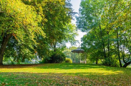 an old gazebo in a sunlit park in autumn photo