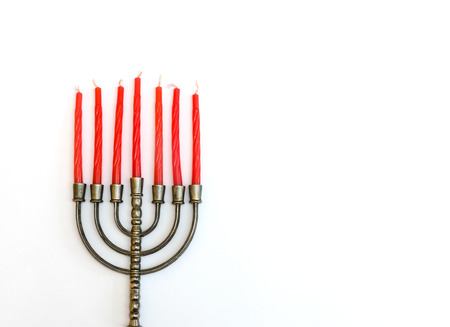 Menorah, the traditional Jewish candelabrum, with red candles photo
