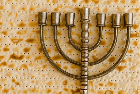 Menorah, the traditional Jewish candelabrum, on Matzo photo