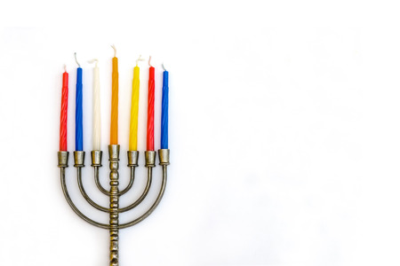 Menorah, the traditional Jewish candelabrum, with colorful candles photo