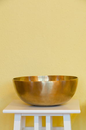 music therapy: therapeutic Tibetan singing bowl on a pedestal