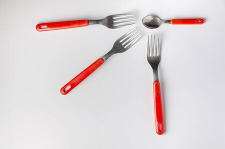 surrounded: tea spoon surrounded by forks