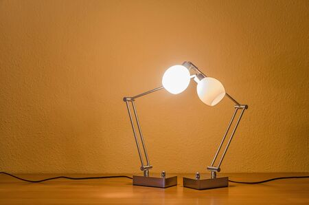 table lamps: two lit table lamps supporting each other Stock Photo
