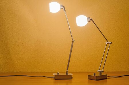 lit lamp: one lit lamp following another Stock Photo