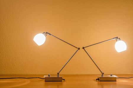 table lamps: two lit table lamps turned away from each other Stock Photo