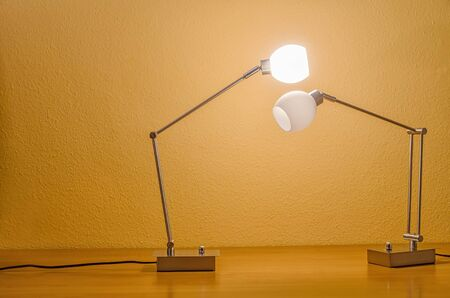 table lamps: two modern table lamps, one turned off