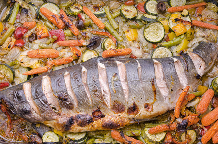 baked wild salmon with a variety of vegetables photo