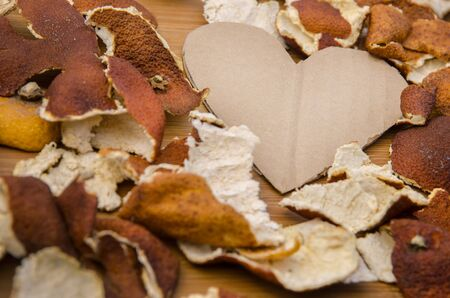 cardboard heart in between dried citrus peel photo