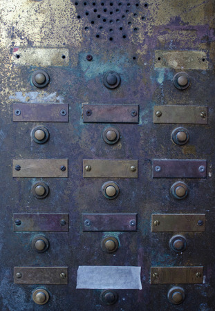 intercom: retro grungy apartment doorbell buzzer intercom with empty name plates