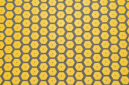 acupressure: top view of an acupressure mat with regular pattern of disks with spikes Stock Photo
