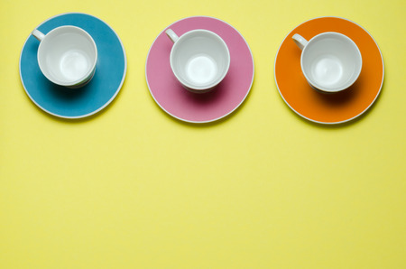 overview of three cups on colorful plates photo
