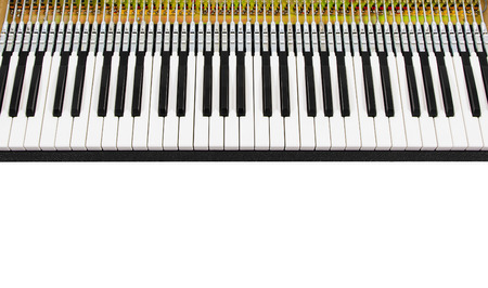 function key: close-up of a mechanical piano with keyboard and the inside structure on white background