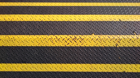 barricade: yellow and black warning metal barricade with pattern