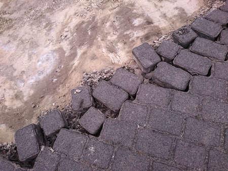 diagonally: brick pavement dissolving diagonally into sand