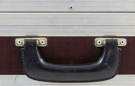 safe and sound: close-up of the handle on metallic protective case for music equipment