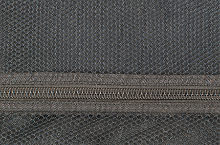meshed: closed zipper in a meshed textured textile Stock Photo